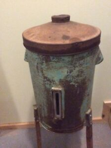 Antique Primitive Gravity Cream Seperator Can In Green On Wooden Legs