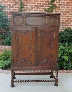 Antique English Oak Jacobean Cabinet Chest With Drawer On Barley Twist Stand