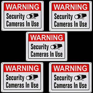 Metal Home Security Camera System In Use Recording Warning Yard Sign Lot