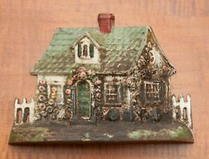 1920 S Cast Iron Door Stop Cottage With Fence Pickets On Left And Right