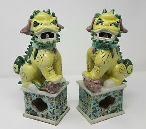 A Pair Of Chinese Famille Verte Porcelain Buddhist Lions