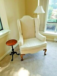 White Wingback Chair And Small Side Table