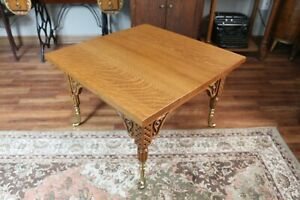 Antique Tiger Oak Table With Beautiful Carving And Brass Leg Tips