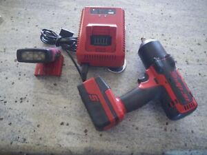 Snap On 1 2 Impact 7850 With Charger Battery And Led Flashlight