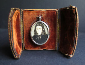 A Victorian Travelling Frame With Painting Of A Youg Lady In Silver Locket