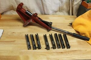 VINTAGE CH RELOADING PRESS W 9 DIFFERENT CALIBER RAMS AND 2 PRIMER ARMS BULLET