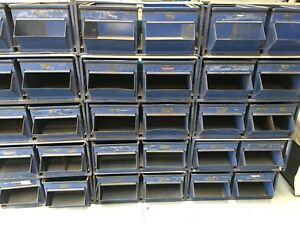 30 Stackbin Storage Containers With Storage Cabinets Each Cabinet Holds Two Bins