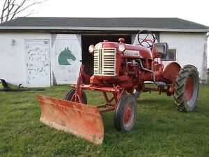 Farmall Cub Tractor With Two Attachments And Two Sets Of Tires