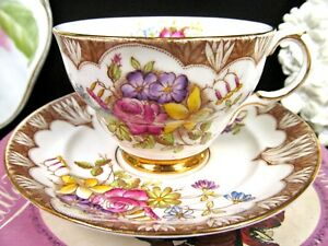 Rosina Tea Cup And Saucer Painted Floral Rose Pattern Teacup Footed Gold Base