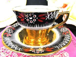 Rosina Tea Cup And Saucer Gold And Painted Teacup All Gold Base With Black Red