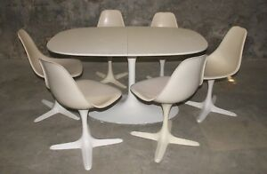 Burke Tulip Base Oval Table W 2 Leaves 6 Swivel Chairs W Propeller Base