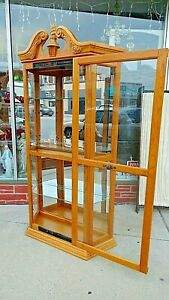 Curio Display Oak Cabinet With Sliding Door Lighted Mirrored Back Carved Top