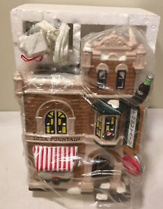 Dept. 56 Coca-Cola Corner Drug Store Plus Delivery Men and Neon Sign
