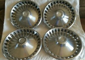 4 Vintage 1960 s 1970 s Plymouth Motor Division 14 Hubcaps Wheel Covers