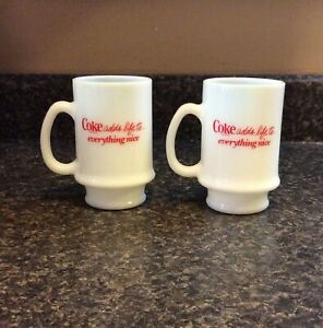 """2 COCA COLA """"COKE ADDS LIFE TO EVERYTHING NICE"""" Milk Glass Footed Mugs"""
