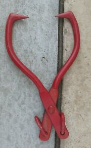 Pair Of Red Metal Log pole Tongs Used Is In Good Condition