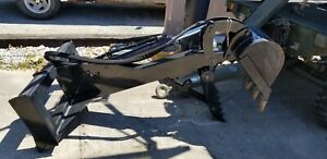 Skid Steer Back Hoe Attachment With Adjustable Grapple