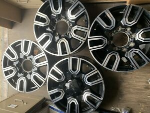 Used Set Of Four 20 Inch Gmc Sierra Wheels With Center Caps