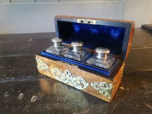 An Antique Walnut Brass Bound Domed Box With Silver Topped Bottles