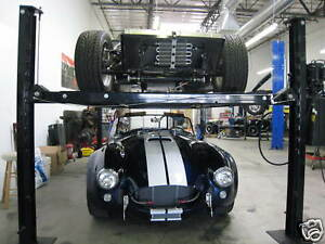 Four Post Vehicle Lift 100 Portable 7000 Lb Roll Around Stacker Must Read Ad