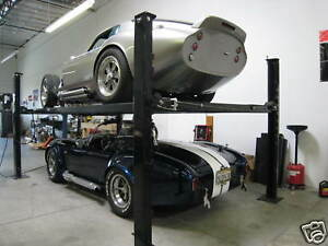 4 post Car truck Lift 100 Portable 7000 Lb Roll around Stacker Storage Lift