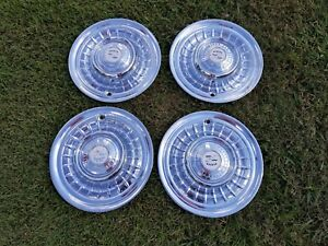 1959 Cadillac Hubcaps In Good Shape