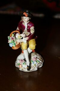 Antique Figurine Sitzendorf Young Boy Holding Basket Of Flowers