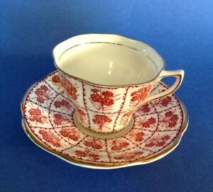 Rosina Tea Cup And Saucer Red Latticework With Flowers Gold Rims England