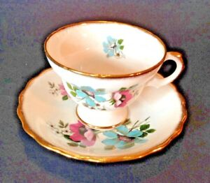 Rosina Pedestal Teacup And Saucer Pink And Blue Poppies Wide Gold Borders
