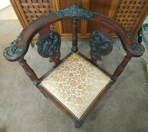 Antique Carved Wood Chippindale Style Corner Chair With Cherub Head Accent