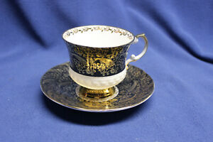 Elizabethan Footed Tea Cup Saucer Fine Bone China England Black Gold White