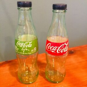 COCA COLA SALT AND PEPPER SHAKERS (1 Green/1 Clear Bottles) LABEL IS PERMANENT