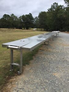 Stainless Steel Sectional Conveyor W motor located In Sanford Nc