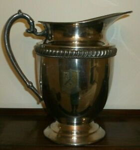 Vintage Silver Plate Water Pitcher With Medallion