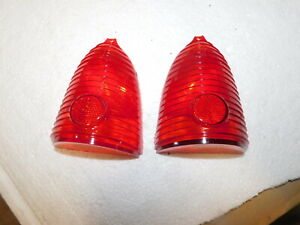 A Pair Of 1955 Chevy Tail Light Lenses With The Inner Lenses