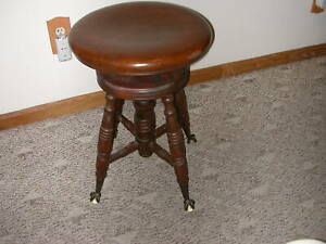 A Merriam Antique Wood Piano Stool Glass Ball Claw Feet Adjustable Seat