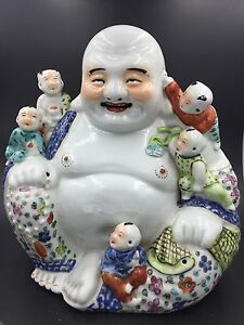 A Large Chinese Famille Rose Porcelain Sitting Buddha Boys You Longsheng