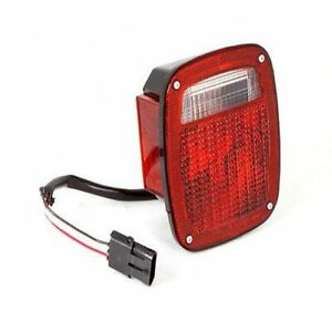 Omix ada 12403 11 Left Tail Light With Black Housing For Jeep Wrangler Yj 87 90