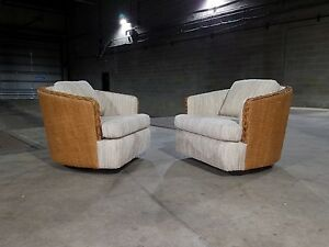 Pair Of Upholstered Rattan Swivel Barrel Lounge Chairs