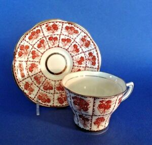 Rosina Tea Cup And Saucer Red Brown Latticework With Flowers Gilded Accents