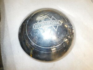 A Vintage International Hub Cap