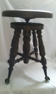 A Merrium Antique Wood Piano Stool Glass Ball Claw Feet Spin Adjustable Seat
