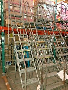 10 step Industrial Rolling Ladder With Base Lock Engage Step Reaches 8 6