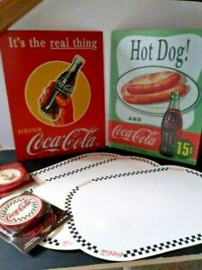 COCA COLA COLLECTIBLES SIGNS (2) PLACE MATS (3)  COASTERS (2) SEALED PACKAGES