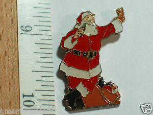 Santa Claus Coca Cola Pin  with Candy Canes and PresentsLapel Pin dated 1994