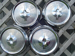 1957 Oldsmobile Custom Cruiser Jetstar Starfire Rocket Holiday Fastback Hubcaps