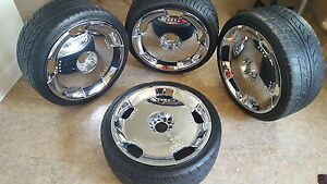 Four Set Of Rims On The Tires