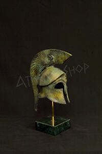 Ancient Greek Bronze Helmet With Owl On A Marble Base