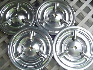 1957 57 Oldsmobile Custom Cruiser Jetstar Starfire Rocket Holiday Fiesta Hubcaps