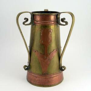 A Russian Arts And Crafts Three Handled Brass And Copper Vase